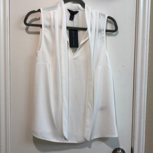 White chiffon blouse with tie detail. New with tag